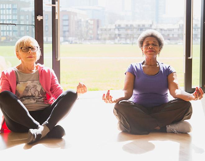 mature women doing yoga