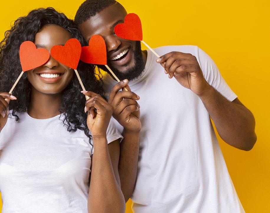 couple holding up heart eyes